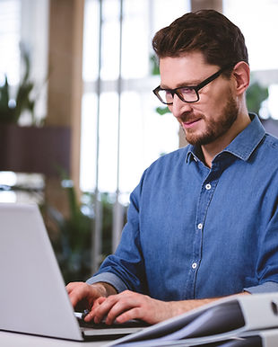 confident-businessman-working-on-laptop-