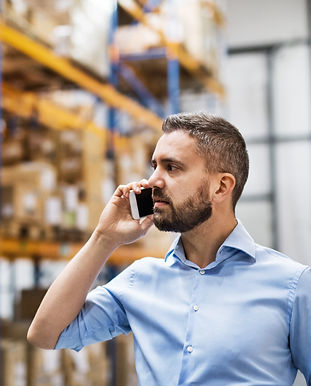 warehouse-worker-or-supervisor-with-a-smartphone-PWPF4M5.jpg