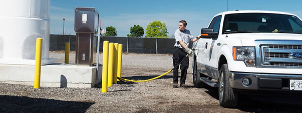 Propane autogas dispenser, refueling procedure, man filling the Ford pickup truck with LPG