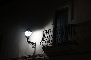 Vejer by night, street lamp and balcony.