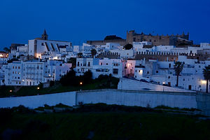 Vejer old town skyline at dusk.