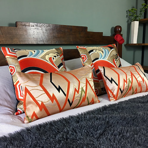 Bolster cushion in metallic geometric zigzag obi silk