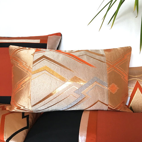 Bolster cushion in copper geometric zigzag obi silk