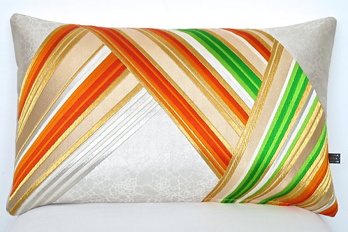 Bolster cushion in rainbow zigzag stripe
