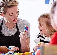 Woman and child looking at toy