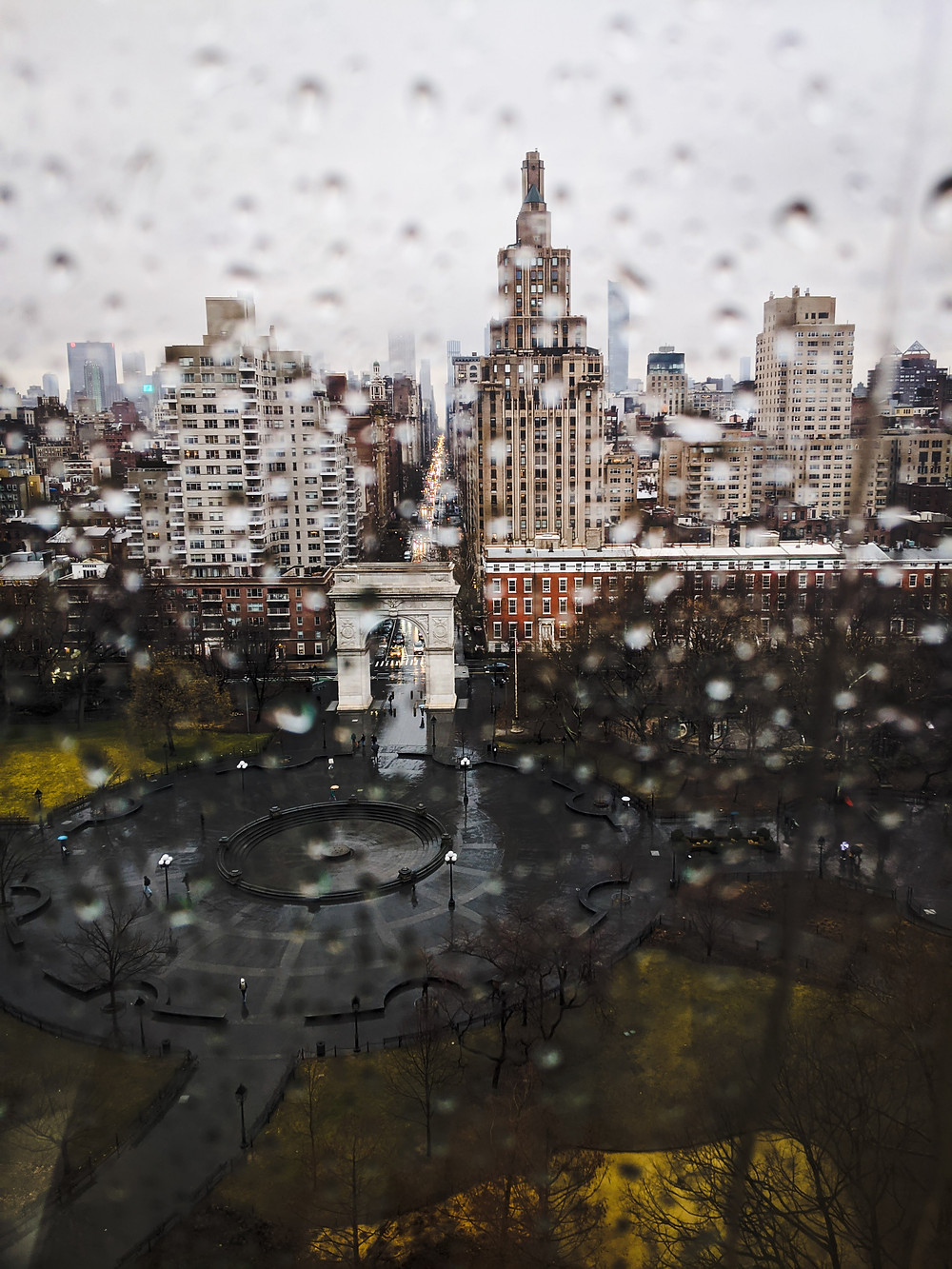 Blurred water droplets through a window overlooking Washington square park, take from 10th floor of New York University's Kimmel Center