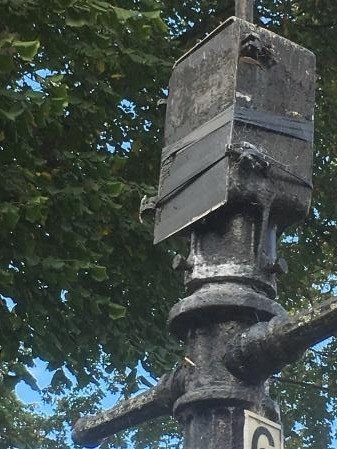 Picture of a damaged Junction box with tape holding the cover together.
