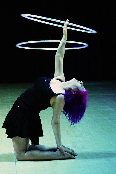 Jenie Brennen Hoop Artist performing a stage show.