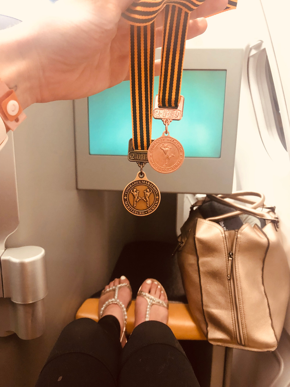 Comrades medals on the plane