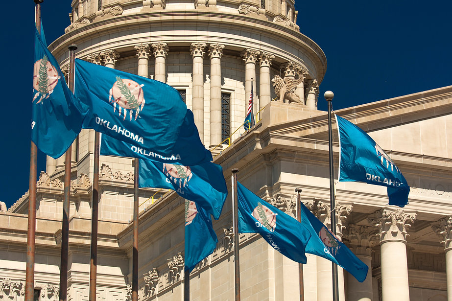 oklahoma capitol with flags.jpg