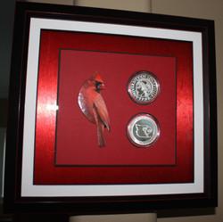 Shadowbox with coins, bird cutout