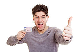cheering-man-with-driving-license-holds-