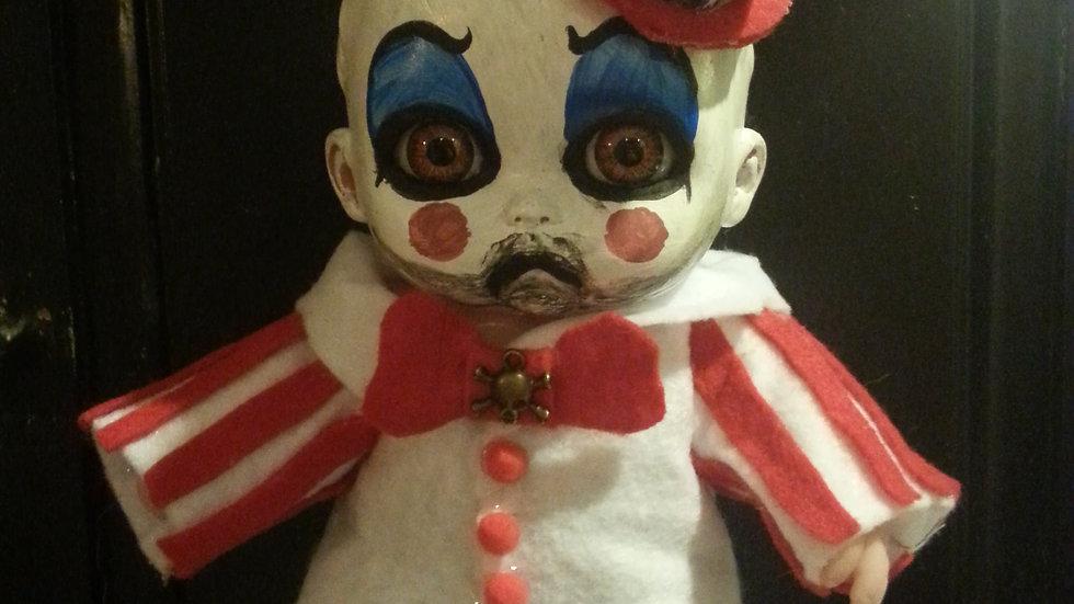 Cute little Captain Spaulding doll