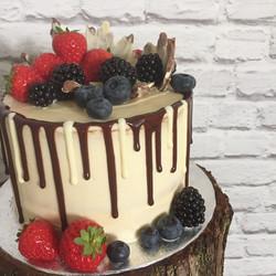 Chocolate drips and fresh berries