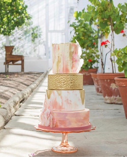 Coral and gold wedding cake