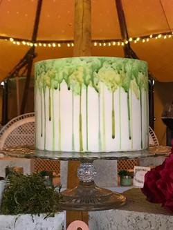 Green watercolour drip cake