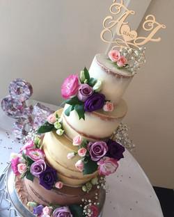 Tall semi-naked wedding cake