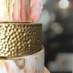 Peach and gold wedding cake