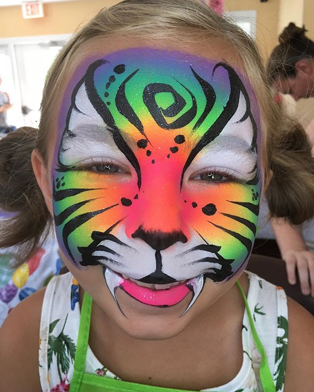 Neon Rainbow Tiger Face Painting