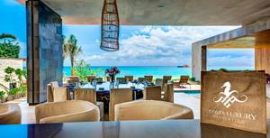 """Impresionante Residencia frente al mar en venta.     La casa ofrece 1352 m2 de construcción cubierta más 773 m2 de terrazas, en un lote de 1731 m2 con 22.7 metros de frente de playa.     Esta magnífica residencia de 7 dormitorios, con un estilo moderno y contemporáneo y con detalles mexicanos, está diseñada por el reconocido despacho de arquitectos """"Sordo Madaleno"""" (www.sordomadaleno.com). Está ubicado en la comunidad privada y exclusiva de Playacar Fase 1 con acceso controlado, frente a un parque màgico con antiguas ruinas mayas."""