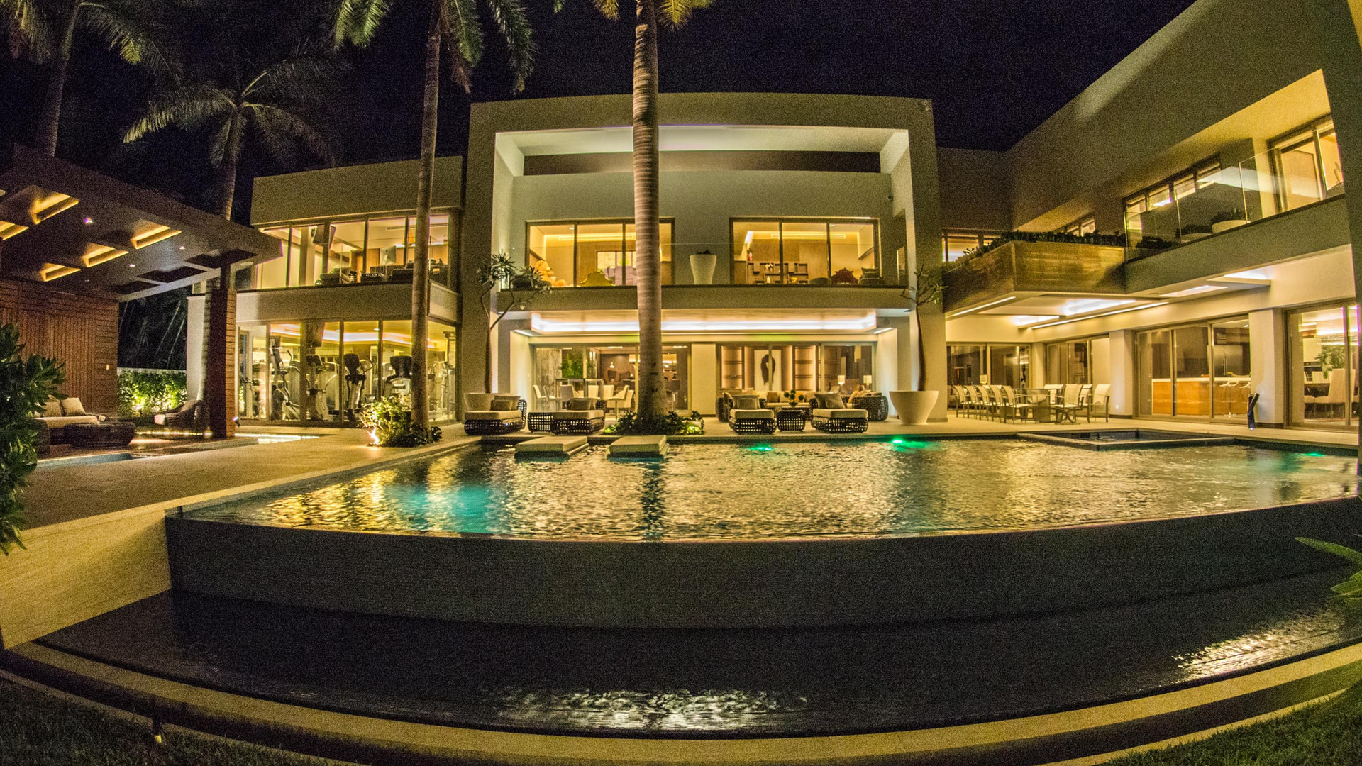 The location offers the best restaurants and shopping malls just a view minutes by foot and the airport is just 20 minutes away. This residence is 17,222 Sq.ft on a 0.75 acre lot (including 3230 Sq.ft of federal zone), 129 feet lagoon front and 218 feet deep. It sells fully furnished and offers very luxury high-end appliances, including a separate commercial kitchen. An executive office with an additional direct entrance from outside the home, a large gym, a private dock, and wonderful views of the lagoons make this property the perfect place for family living or a corporate getaway. The modern layout is well planned with great natural light and very spacious areas. The building offers 100% hurricane protection. This incredible property is one of the most luxurious residences built in Cancun.
