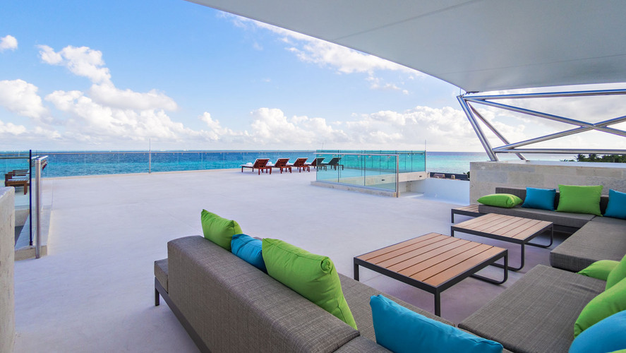 This luxurious residence of 26,159 Sq.Ft. of meticulously-built construction has wide-open ocean views from three levels. It is built on 0.5 Acres double-width lot (82 feet ocean front) that has more than double the usual depth, which allows the house to be set back from the beach, giving the owners all of the view, but much more privacy, than any other lot in Playacar Phase 1.