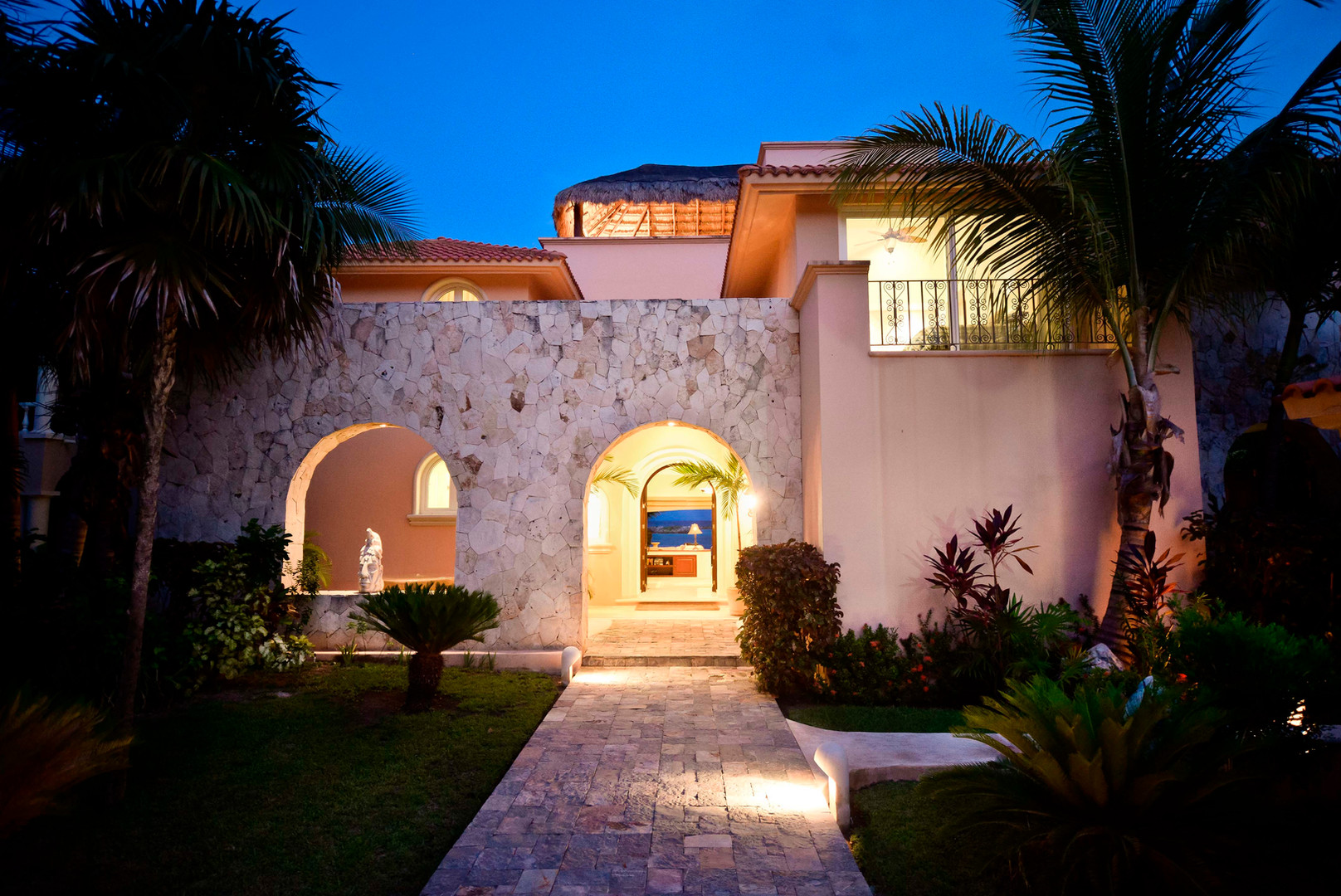 A unique Beach Residence at one of the most thought after beaches in Puerto Aventuras, a Gated Community between Playa del Carmen and Tulum.   9,090 s.f. of construction, 0.387 acres, 68 feet of beachfront. Four bedrooms, TV room, four half bathrooms, open living and dining area, fully equipped kitchen, two storage rooms, washer/dryer room, roof garden with palapa and lounge area. Pool, BBQ area, wooden sun deck, private beach in a protected bay. Covered three-car garage and plenty additional parking space. Fully equipped bungalow for onsite service personnel. Backup electricity generator. Very well maintained, excellent rental income!