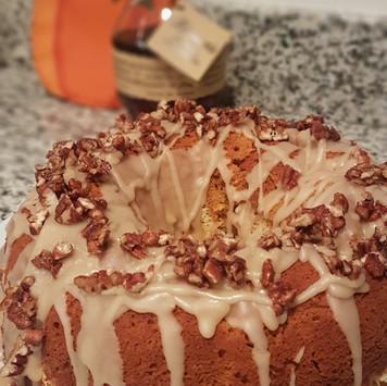 Cheesecake-Stuffed Pumpkin Spice Cake with Bourbon Glaze