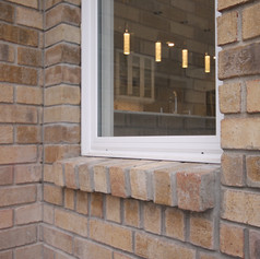 We replaced an exterior door with a new window. The new brick is indistinguishable from the original!