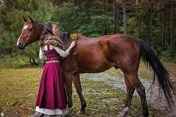 Pond Bekah beside a horse