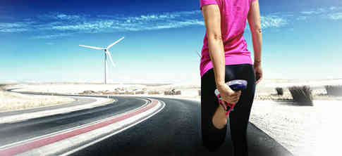 young-female-runner-stretching-before-jogging