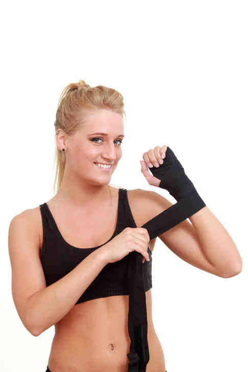 woman-wrapping-her-hands-for-a-wrestling