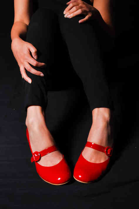 woman-legs-in-red-high-heel-shoes