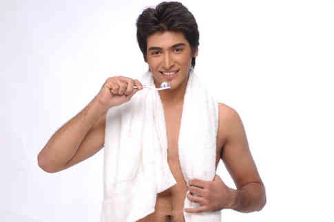 young-man-brushing-teeth