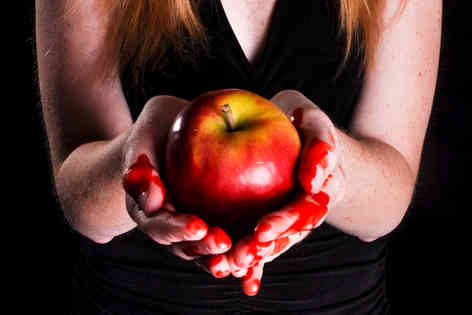woman-holding-bleeding-apple-sin