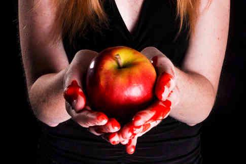 woman-holding-bleeding-apple-sin