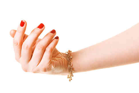 woman-hand-with-gold-bracelet