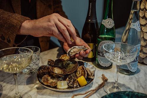 12 oesters met sjalot vinaigrette, citroen en oestermes