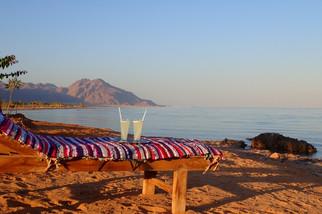 Enjoying the beach view watching the mountains of ras shetan