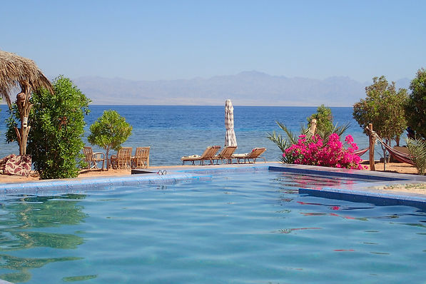 Swimming pool in front of the sea
