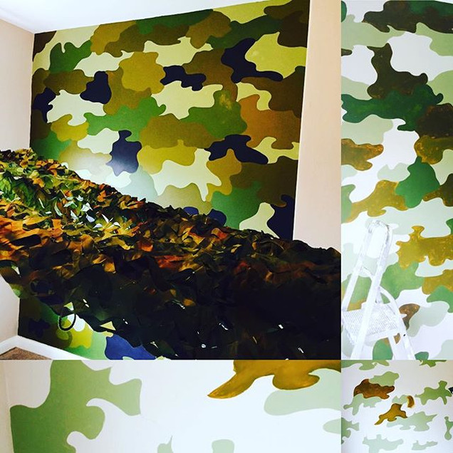 Camouflage painted wall for a little boy