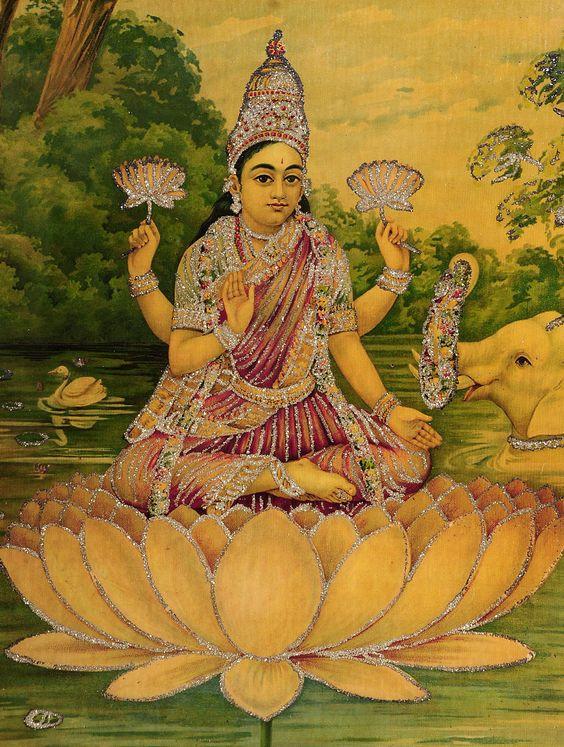 assisse sur un Lotustenant un lotus avec une main droite et une main gauche, 2 autres main en varada et abya  mudra