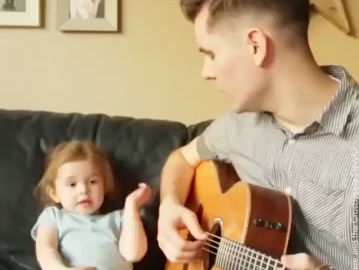 Check out this amazing little girl singing...soooo cute!!