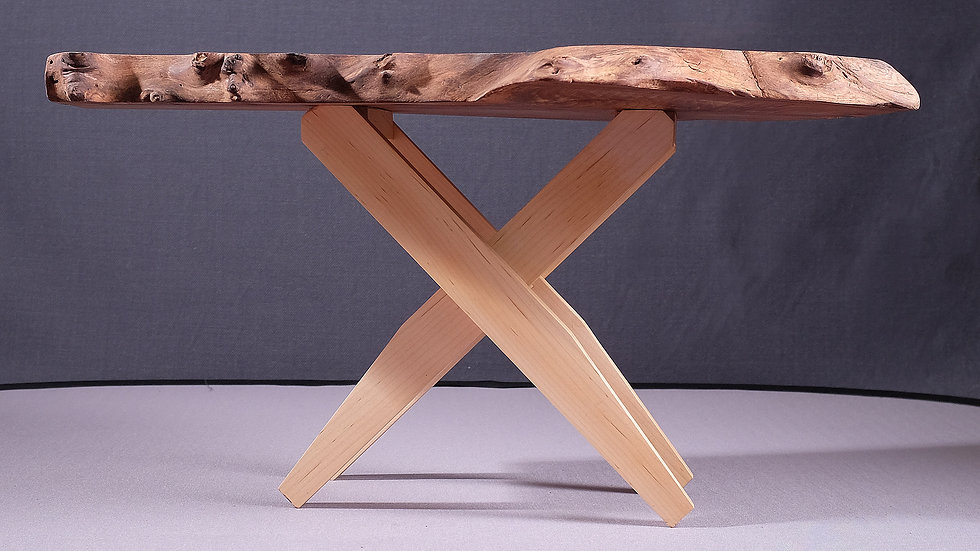 Yew natural edge coffee table with ash legs