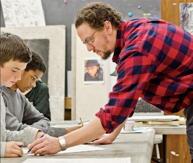 Mr. James DeCesare instructing his art students