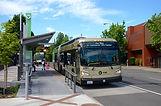 1200px-Bus_at_Washington_&_12th_Vine_station_in_2017.jpg