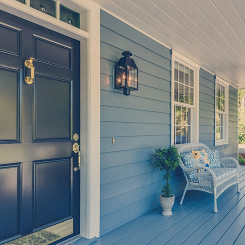 A beautiful home with a view of the front porch representing buyers and sellers in a residential real estate transaction.