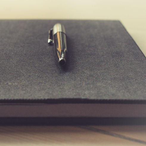 A pen and notebook for business formations and legal matters.