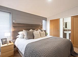 Prestige Dovecote holiday lodge master bedroom.webp