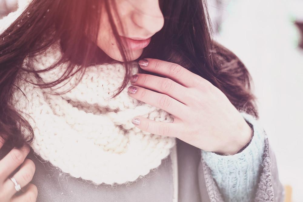 Girl wearing a white wool scarf